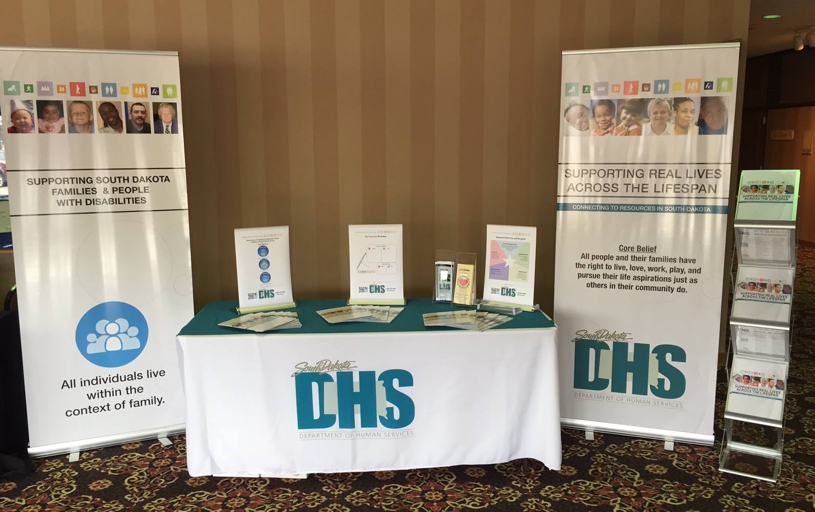Photo: Custom display banners and booth materials using the LifeCourse framework branding developed by the South Dakota Department of Human Services